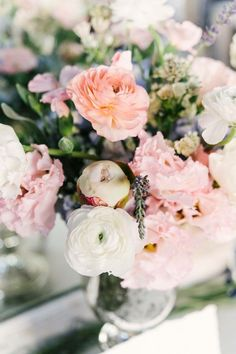 Pink roses and pops of white and blue for a spring wedding