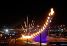 The Olympic Cauldron is lit during the opening ceremony of the 2014 Winter Olympics. (Julio Cortez/AP)