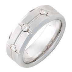 Serinium® Band with three .06 Round Diamond Brilliant Cut Stones set in Bezels with a Satin Finish