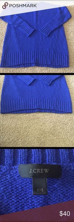 J.Crew Crewneck Sweater Beautiful royal blue J.Crew crewneck sweater. Oversized fit with a slight elliptical hem. Fun detailing on front. In great condition- minor pilling. J. Crew Sweaters Crew & Scoop Necks
