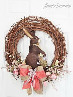 Easter Wreath - Making a wreath is easy with this step-by-step photo tutorial! This wreath has little eggs, carrots, burlap ribbon, and beautiful flowers!