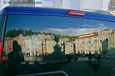 reflections off cars | piazza-car-reflection.jpg bell towers, cars, europe, horizontal ...