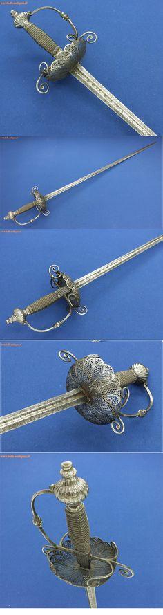 A very nice 17th Century Spanish Cuphilted Rapier by FRANCESCO RUIZ AN TOLEDO, length 107 cm, in good condition.