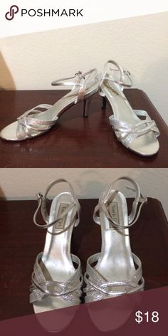 Silver Dress Shoes Worn once! Beautiful silver dress shoes. Size 8 1/2. Straps in perfect condition! Touch Ups Shoes Heels
