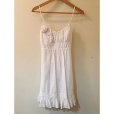 Beautiful white summer dress A beautiful white summer dress with crochet and ruffled hem details shoulder to hem length: 34in with adjustable straps :) Dresses