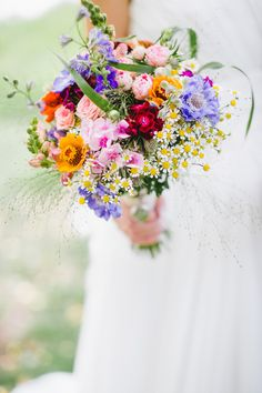 "These flowers say ""I walked through a meadow and picked these."" Beautiful Spring Wedding bouquet."