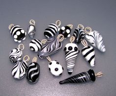 How Sharon Makes Glass Headpins - Page 2 - Lampwork Etc. silver wire and epoxy
