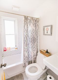 The shower curtain is from Anthropologie and the hairbrush print is from Rifle Paper Co.