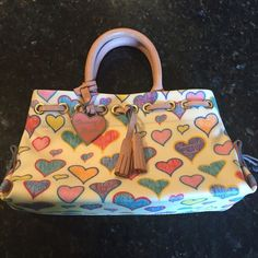 Dooney & Burke Purse Mint condition, just missing the tags Dooney & Burke Purse. Has been stored in a smoke free home. Used maybe 2 times. Dooney & Bourke Bags Mini Bags