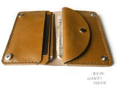 Leather wallet color of brown on the button with pocket for small items. Made of brown leather. In this leather wallet can be loose accommodate credit cards, cash, there is a special compartment for coins. This small wallet. You can put into a few banknotes, 2-3 credit cards and a small amount of coins. This wallet is a good gift. The original, comfortable, functional. Genuine Leather. Handmade - handmade seam. Approximate size: 7,5 x 11 cm (1 inch = 2.54 cm). Every product I make by han...