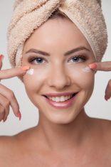 Woman applying facial mask stock photo