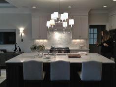 Heather Garrett Design: Stunning kitchen opens to living room. Crisp white shaker kitchen cabinets paired with ...