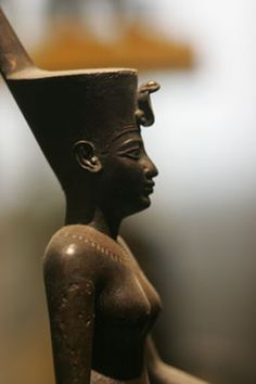 Neith wearing the Deshret crown of Lower Egypt