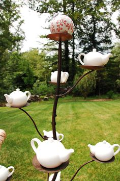 My love made me a bottle tree for Valentines' a few years ago, guess what I want this year. Of course, i'm going to have to start looking or calling   my friends for teapots that may be heading to the trash. I just can't PART with any of mine, even on a tree.