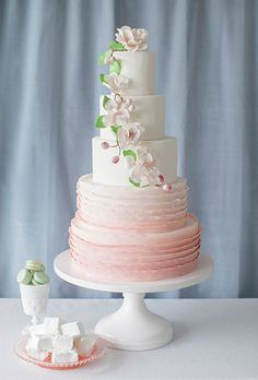 Pink Ombré Five-Tier Round Wedding Cake With Ruffles and Sugar Flowers