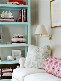 pretty pastels in blue and pink.  love the bookshelf details and ikat bolster.