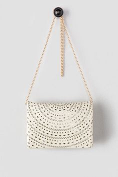 Add some flair to a casual outfit with this versatile clutch.