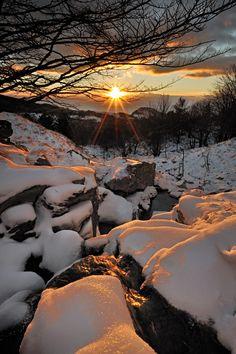 Over the snow sunrise, Liguria, Italy