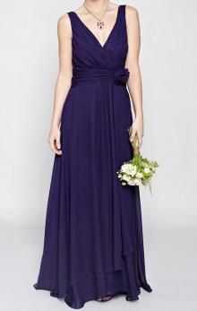 Elegant long navy chiffon bridesmaid dress. The wrap v neckline sleeveless bodice with soft ruched pleating is flattering on any figure and features a delicate rose corsage that is removable. The light and draped pleated chiffon falls elegantly on the body and has a full skirt to to give a beautiful silhouette.