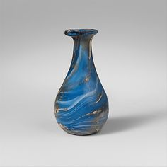 Marbled glass perfume bottle Period: Early Imperial Date: early to mid-1st century A.D. Culture: Roman Medium: Glass; blown, trailed, and ma...