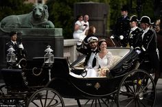 Sharing the moment: Prince Carl Philip of Sweden and his wife in their wedding cortege following the ceremony this afternoon