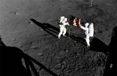 "TRANQUILITY BASE Armstrong and Aldrin deply the American flag outside the lunar module ""Eagle"" at Tranquility Base in the Sea of Tranquility on July 20, 1969."