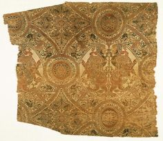 Fragment with wrestling lions and harpies  Spanish (probably Almería)  , Early 12th century  50 x 43 cm (19 11/16 x 16 15/16 in.)  Silk lampas with supplementary discontinuous metal-wrapped patterning wefts