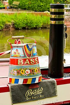 Narrow boat traditional decorated watering can. by Jlcst, via Dreamstime Or use a beer theme