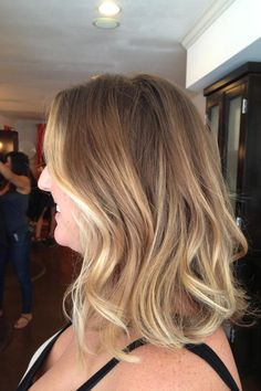 Sunkissed blonde balayage and hairstyle