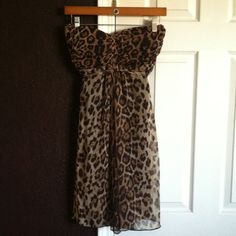"Strapless cheetah dress Super sexy and fun ! Elastic top with a tie that ties under chest . Also has a built in bra .Fits true to size . Fully lined . 28"" from top to bottom . Sans Souci Dresses Midi"