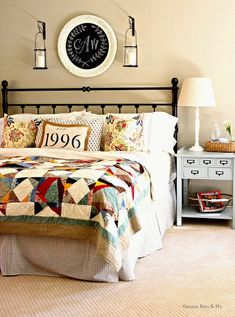 Love the chalkboard painted platter over the bed with the monogram.  Country Style Master Bedroom in Charming Suburban Home