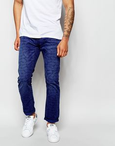 "Jeans by Scotch & Soda Cotton canvas All-over-print Concealed zip fly Two front and two back pockets Slim fit - cut closely to the body Machine wash 100% Cotton Our model wears a 32""/81cm regular and is 188cm/6'2"" tall"