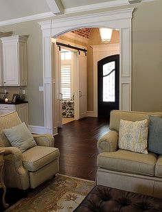The entry space in this new custom home features a barrel ceiling, with a sliding barn door into the office ... the space opens into a large open concept area with vaulted ceilings ... from Trent Williams Construction, Tyler, Texas