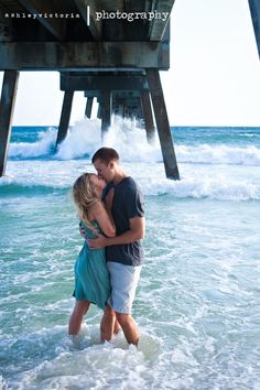 Destin Ft Walton Beach Engagement Session at the pier.  It was so windy from the oncoming storm that the ocean waves were crashing & throwing beautiful sea spray! | View more from this session: http://www.ashleyvictoriaphotographyblog.com/2011/10/19/julia-mark-are-engaged/