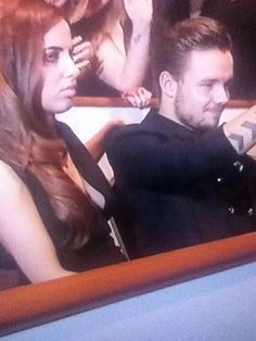 Liam and Sophia<<< No hate but I never see her smile… SMILE GIRL YOUR WITH LIAM FREAKING PAYNE!<<< she does smile just not  in public, she's just not used to the cameras and fans