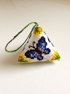completed Cross Stitch - Butterfly Scissors fob/Pincushion/Key ring accessory. $10.00, via Etsy.