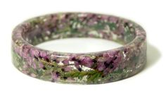 Real tiny pink flowers and green foliage has been handpicked, dried and embedded into resin and shaped into this one of a kind bracelet. This beautiful slip on style bangle is lightweight and complimentary to the season. Perfect for any flower lover or nature lover.