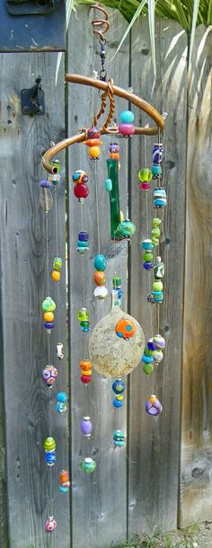 22 Ideas For Yard Art Ideas Wind Chimes Mobiles Bead Crafts, Diy And Crafts, Arts And Crafts, Mobiles, Blowin' In The Wind, Diy Wind Chimes, Shell Wind Chimes, Garden Crafts, Suncatchers