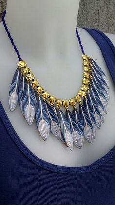 Feathers in blue/polymer clay