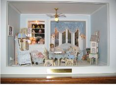 Another Great Box: This box was made for another granddaughter and she uses it as a night light in her room.  The wicker furniture was made by Uncle Ciggie's Miniatures and the other furniture is from Robin Betterley kits.  The chest with drawers is built in with a mirror and glass shelves.  Window treatment was made by Janet Nowicki to match the bedding on the day bed.