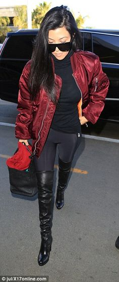 Stepping out! The reality star traveled in style with sexy thigh high boots