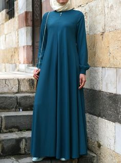 Easy Care Flared Abaya Teal color asked for it, and we are happy to oblige… Kebaya Dress, Hijab Dress, Hijab Outfit, Abaya Fashion, Muslim Fashion, Modest Fashion, Modele Hijab, Eid Dresses, Abaya Designs