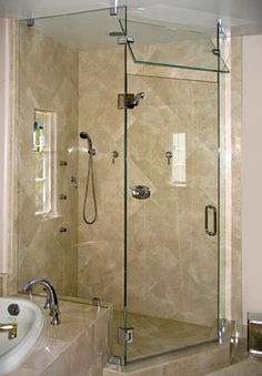 Corner Shower Doors with pivot panel to let out steam. nice design