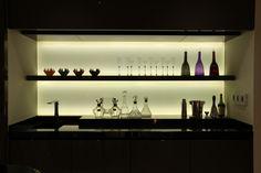 Kitchen shelving display with backlit glass splashback using Contour LED strip lights - http://www.johncullenlighting.co.uk/products/shelf-and-cove-lights/contour/