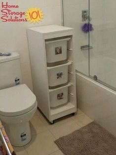Laundry sorter baskets in bathroom, labeled with each person's picture so everyone knows where their stuff goes {featured on Home Storage Solutions 101}