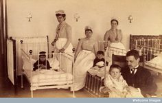 Bellevue Hospital, New York City: children in a ward with nurses and a doctor. 1890    I love old nursing pictures :)