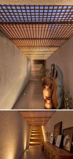 This hallway connects two different areas of this modern house, and a wood screen above compliments the wood stairs and ties in with the other wood details throughout the house. Diy Pergola, Pergola Kits, Modern House Design, Modern Interior Design, Dona Carolina, Sandstone Wall, Monochrome Interior, Modern Hallway, Roof Window