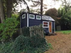 This is a quaint 240 sq. foot tiny house on wheels in Seattle. Outside, you'll notice grey pine clapboards and a matching metal roof on a standard gable-roofed tiny home with dormers for the …