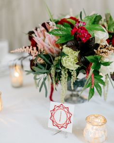 Inspired by an escort card idea on Pinterest, the geometric star table numbers were a DIY project than Susan and Thomas executed together.