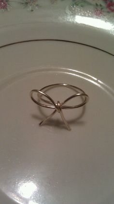 Bow Wire Ring. $3.00, via Etsy.
